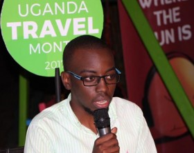 The Pearl Guide Uganda's Philip Kalibwani addresses guests at the Uganda Travel Month media launch.