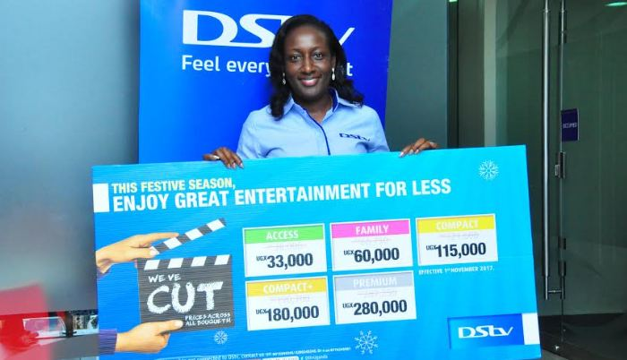 Phoebe Nakabazzi, DStv Marketing Manager displays the new prices for the DStv packages.