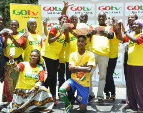 Mandela Luyimbazi , GOtv Sales Team Leader ( left ) , Albert Nga , GOtv Marketing Manager (2nd right ) and Maldinho ( front centre ) pose with the GOtv Kwata Kavu grande Finale winners at the 10th handover event