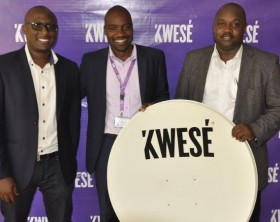 Herbert Mucunguzi (R), the General Manager Kwesé TV Uganda, Collins Mugume (R), the marketing and PR manager and Ben Mwine (C) the General Manager Kwesé Free TV pose for a photo during the Kwesé TV launch in Kampala.