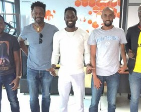 Maurice Kirya (C) poses for a photo with the Sula Pay team.