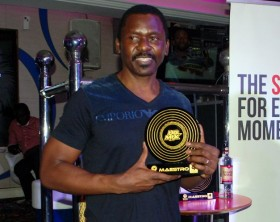 Charlie Lubega receives the Most Outstanding Achievement Award in UG Mix Maestro competition