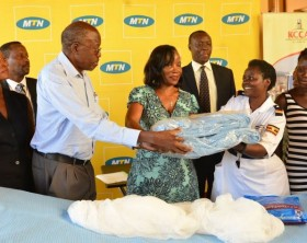 George William Egadu, Chairman MTN Foundation handsover some of the asorted items to KCCA ED, Jennifer Musisi and the staff at Kawaala Health Center