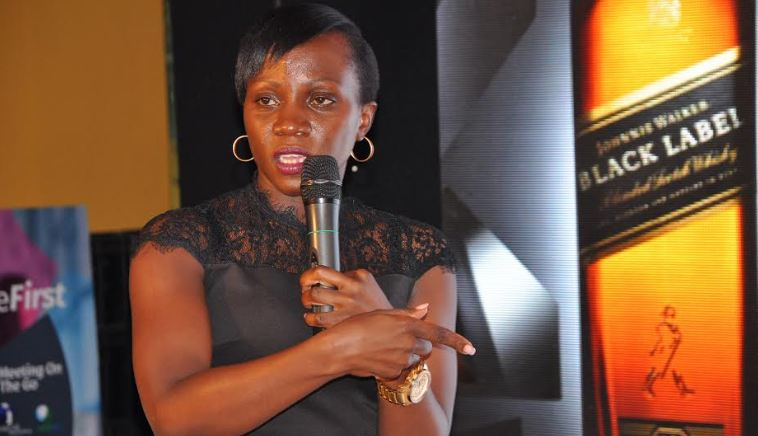 """UBL Head of Spirits Annette Nakiyaga addressing guests during the launch of the """"Paint The World Black"""" promotion"""