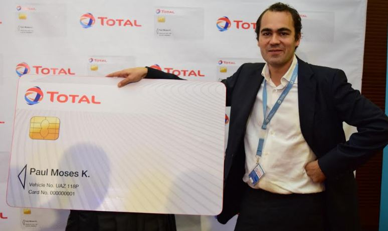 Total Uganda Managing Director, Florentin de LOPPINOT standing next to a dummy of the Total card that was launched at Kampala Serena hotel on Wednesday.