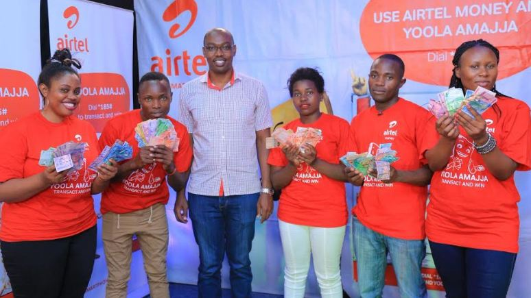 Airtel Uganda Yoola Amajja winners pose with their money after the 8th draw.