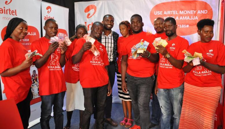 Airtel Uganda Yoola Amajja 9th draw winners pose with their money at Airtel Uganda head office.