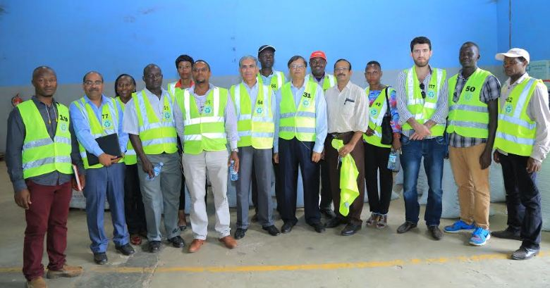 Representatives from the Uganda Water & Juice Manufacturers Association pose for a group photo after a tour of the Plastic Recycling Industries plant in Nakawa.