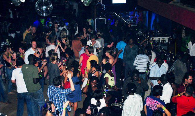 Patrons dance away at a night club in Kampala.