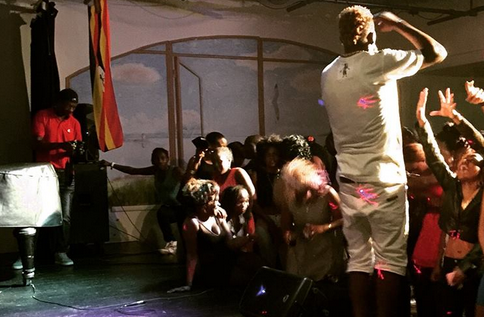 A Ugandan singer entertains revelers in the UK at a recent show.