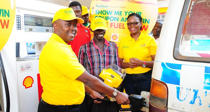 Vivo Energy country sales manager Edward Walugembe and marketing manager Jean Mugisha giving out free fuel to a lucky Taxi driver during the launch of Shell fuel save promotion.