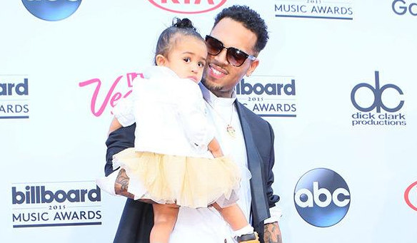 Chris Brown poses with his baby