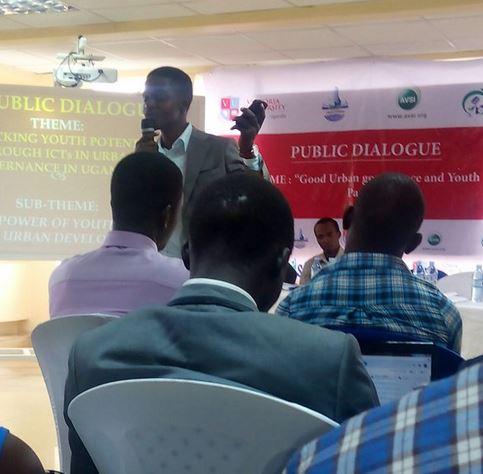Mugisa Howard Anderson, Executive Director Federation of Young Entrepreneurs Uganda, addressing guests at the public dialogue
