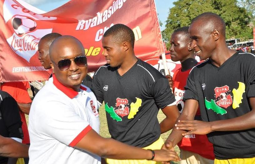 Coca-Cola Uganda Brand Manager greets some of the participants in the Copa Coca-Cola tournament.