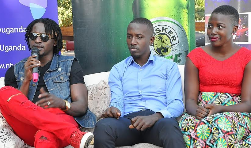 Davis Ntare, the Tusker Project Fame season 4 winner, speaks during a press conference held at Ekombe Villas. Looking on is Tusker Malt Lager Brand Manager, Mr. Alex Tusingwire and songstress Jackie Akello.
