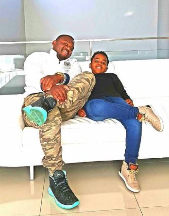 Cameroon Gitawo shows off his son