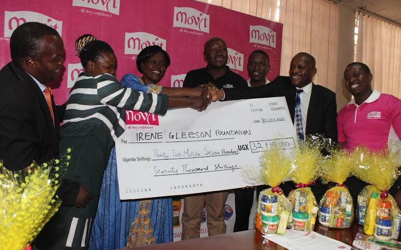 Hon. Beatrice Anywar, Member of Parliament, Kitgum District receives cheque worth 32, 770,000 UGX from Movits products limited to support the Irene Gleeson Foundation.