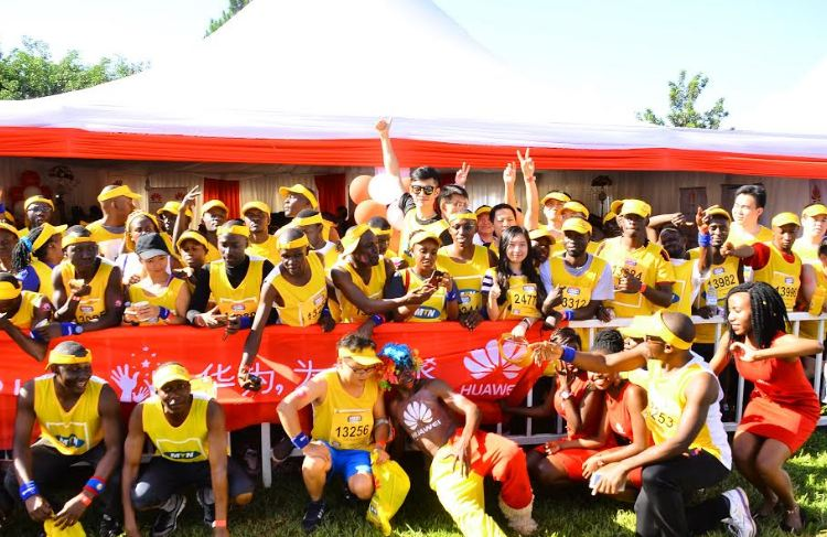 Huawei team poses in front of the Huawei tent during the MTN Marathon held on 20th November 2016.