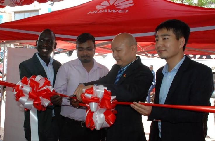 L-R: Sam Cris Ayo, Device Services Manager Huawei Uganda, Bhishma Dave, Telco Head Mitsumi Distribution, Wang Hua, Vice President Huawei Uganda and Zeng Bin, Country Manager Huawei Uganda cut the ribbon to officially open 'Kinetic Shop' Huawei's first brand and service center in Uganda.