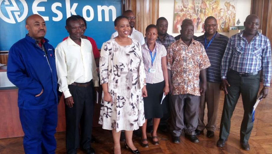 Eskom Uganda Managing Director Thozama Gangi (3rd Left) and Technical Director Mohammed Mahsen (Extreme left) in a group picture with Njeru Municipal council officials after a stakeholder engagement meeting at Eskom offices in Jinja.