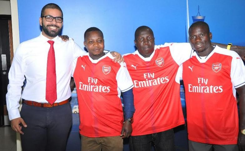 Emirates Country Manager, Mohammad Al Altar poses for a photo with the lucky Arsenal jersey winners at the Emirates offices.