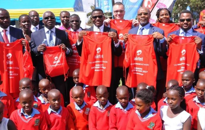 Katikiro of Buganda, Owek. Charles Peter Mayiga (C) officially unveils the Kabaka Birthday Run 2017 kit at Bulange Mengo as other partners look on.