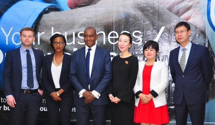 Edwin Mucai, Stanbic Bank (U) Head of Corporate and Investment Banking (3rd left) poses for a group photo at the Africa - China Chinese Economic Forum. Standing with him from left to right are Standard Banks Jeremy Stevens - Economist Beijing, Daisy Nitwe - Corporate Sales Dealer, Ives Wang - Standard Advisory China, Miaomiao Lu Transactional Banker - Stanbic Uganda and Cao Min Standard Bank's Head Chinese Desk East Africa.