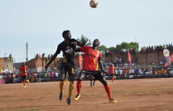Emma Okwi fights for the ball with Eastern Select side player