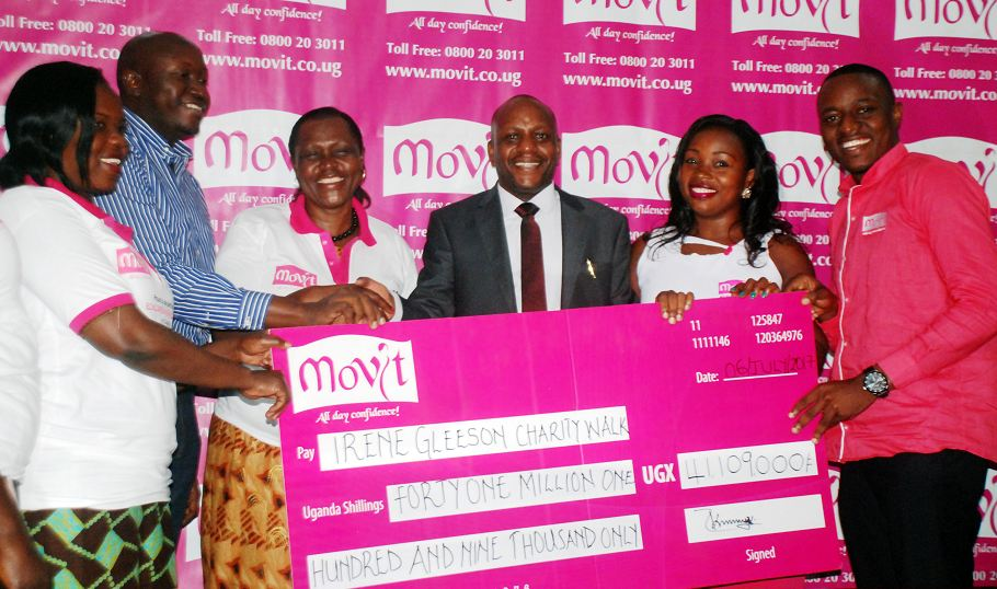 Movit Products Limited hands over a dummy cheque to the Irene Gleeson Foundation