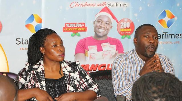 Aldrine Nsubuga, (R) Vice President StarTimes addressing media
