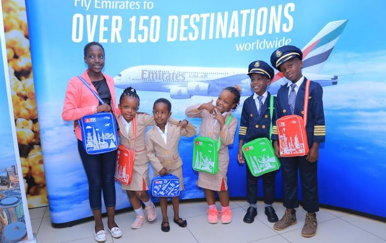 Some of the children who attended the movie screening pose for a photo with their gift hampers from Emirates