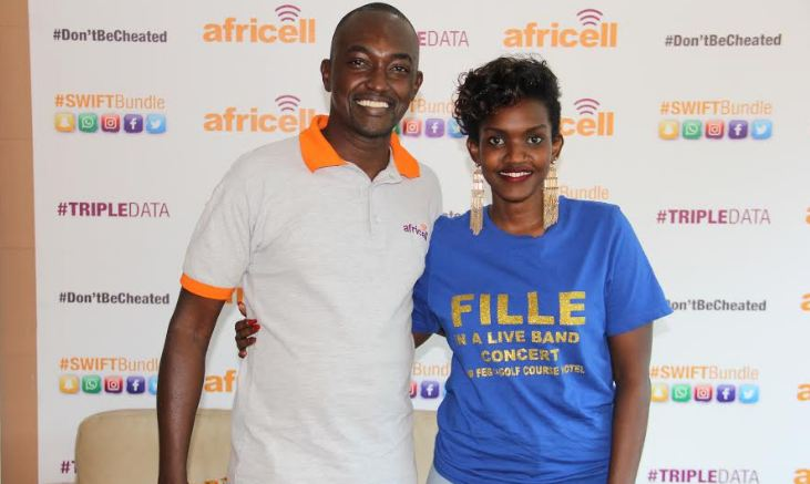 Fille poses for a photo with the Africell Uganda PR Manager Edgar Karamagi