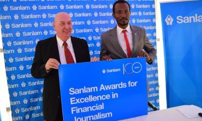 Mr. Gary Corbit the CEO Sanlam General Insurance Uganda(R) together with Mr. Donato Laboke the General Manager; Marketing and Brand launching the Sanlam Awards for Excellence in Financial Reporting.