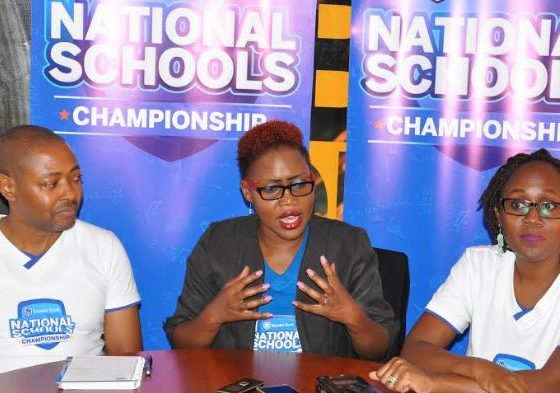 Barbara Kasekende, Stanbic Bank CSI Manager (centre) officially announces the regional winners and semi-finalists of the 2018 Stanbic National Schools Championships. She is joined by Eva Ssewagudde Jjagwe, the in-charge of the Business Incubator (Right) and Martin Muhwezi, the Programme Director at investor Club (Left).