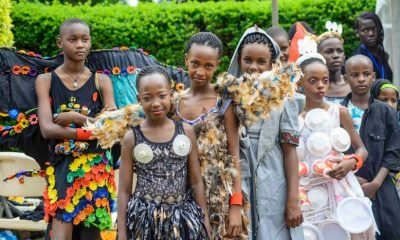 Children show off their fashion designs as produced with the FAAM Club and Njola's Ghetto Wardrobe Campaign