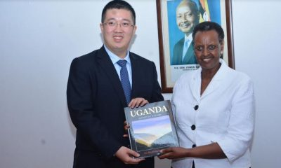 Huawei's New Managing Director Mr. Liujiawei receiving a book about Ugana from the First Lady Hon. Janet Museveni at a recently concluded Seeds for the Future event at State House Nakasero.