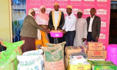 Moslem clerics at Kibuli Mosque receive assorted food stuffs handed over by a team from Movit.