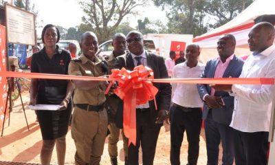 Nansana Municipality Town Clerk Mr. Christopher Kaweesi and DPC Katwaalo cut the ribbon to officially open the Airtel premium shop in Nansana.