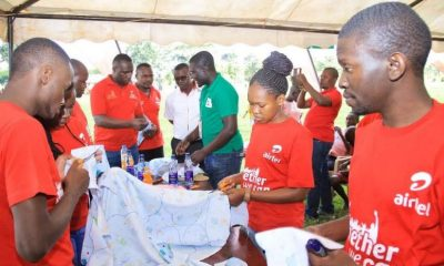 Airtel Uganda and HindsFeet staff members make reusable sanitary towels which were given to young women during the health camp.