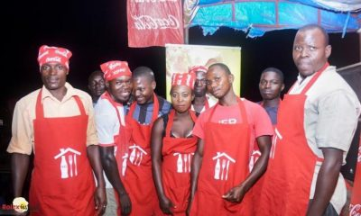 Rolex vendors pose for a group photo during one of the Kampala Rolex festival activations.