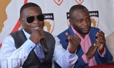 Jack Pemba and Umar Semata(R) address media during a send off ceremony on Monday.