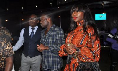 Brian Ahumuza(C), founder of the ASFAs mingles with guests during the nominee unveiling cocktail.