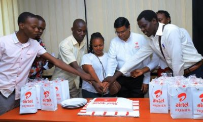 Airtel Uganda MD V.G. Somasekhar is joined by staff and customers to cut cake during the Customer Service Week.