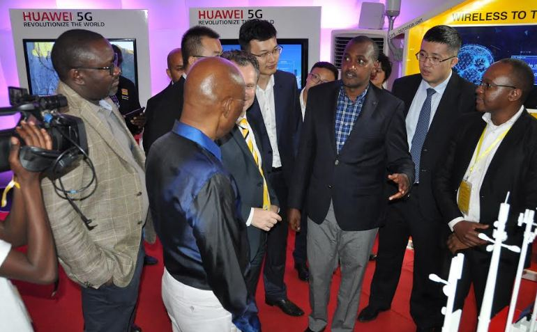 ICT Minister Frank Tumwebaze (3rd right) with other officials learn about the 5G in the Huawei booth during the MTN expo at Kololo Independence Grounds.