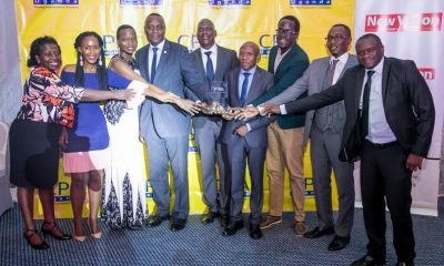 The NSSF team pose for a photo after receiving the Gold Award at the Financial Reporting Awards (FiRe Awards) that were held at Kampala Serena Hotel.