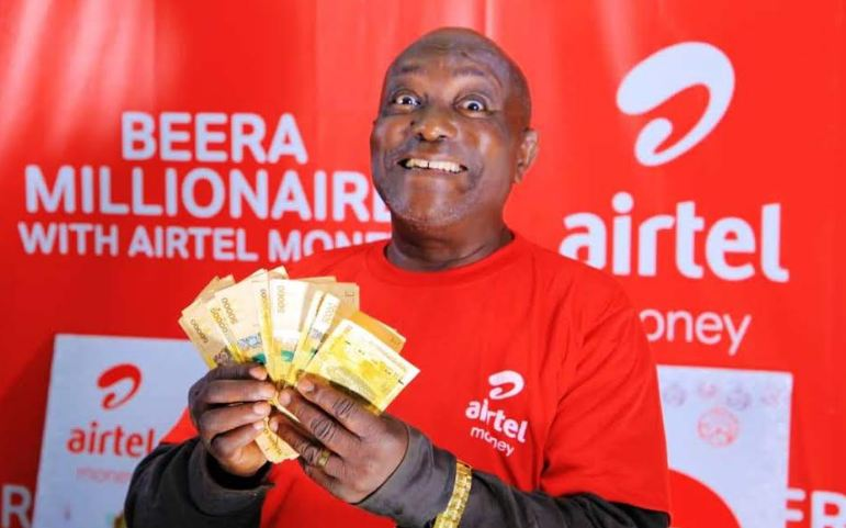 An excited winner with his money.
