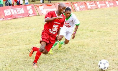 Uganda's, Derrick Kaija (left), has his eyes glued to the ball, as Standwell Kamanga, from Malawi, attacks.