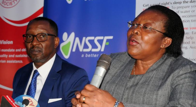 Dr. Dorothy Kyeyune Byabazaire, Director Uganda Blood Transfusion Services addresses media during the launch of the  NSSF blood donation drive held at Mulago Hospital on Monday. Looking on is NSSF Managing Director Richard Byarugaba.