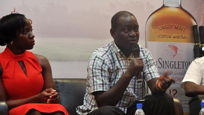 Edwin Tumusiime, the Entebbe Golf Club captain addresses media during a press briefing held at the Kampala Serena Hotel on Tuesday morning. Looking on is the Annette Nakiyaga, UBL's Head of Luxury Portfolio.