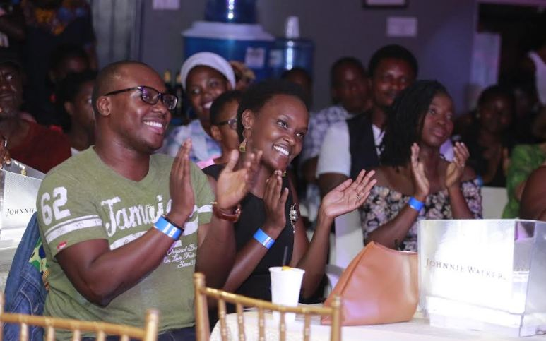 Revelers enjoying performances at the Johnnie Walker Unplugged show.